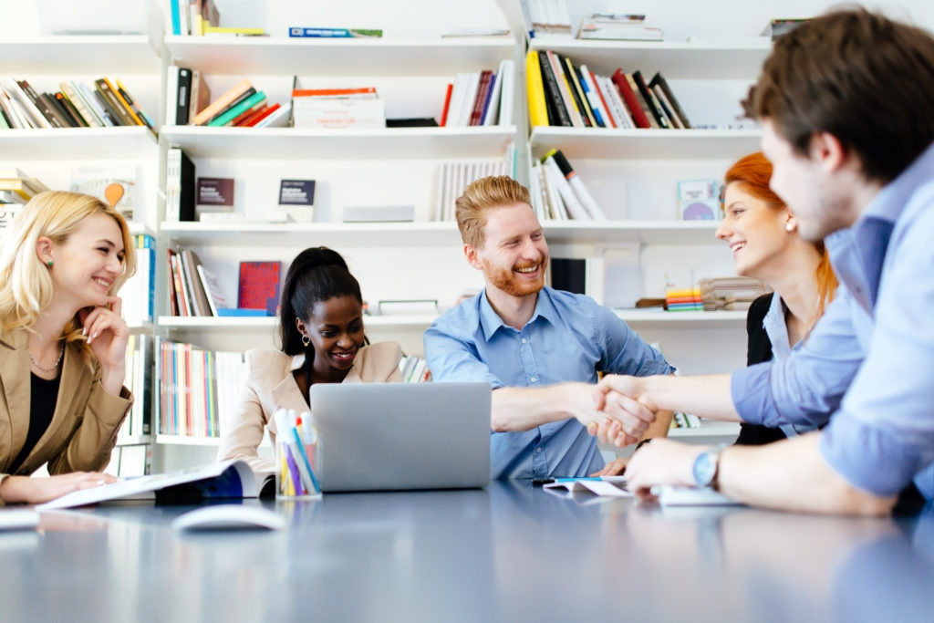 Successful partnership in business displayed by shaking hands in office