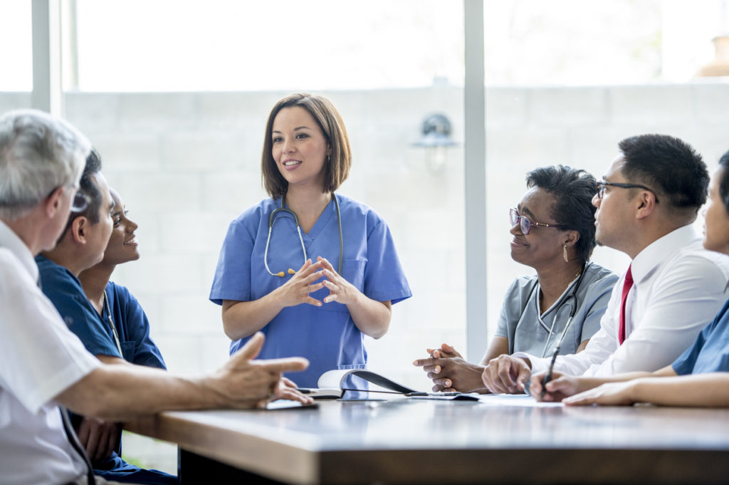 Doctors and patients working together to discuss diagnosis