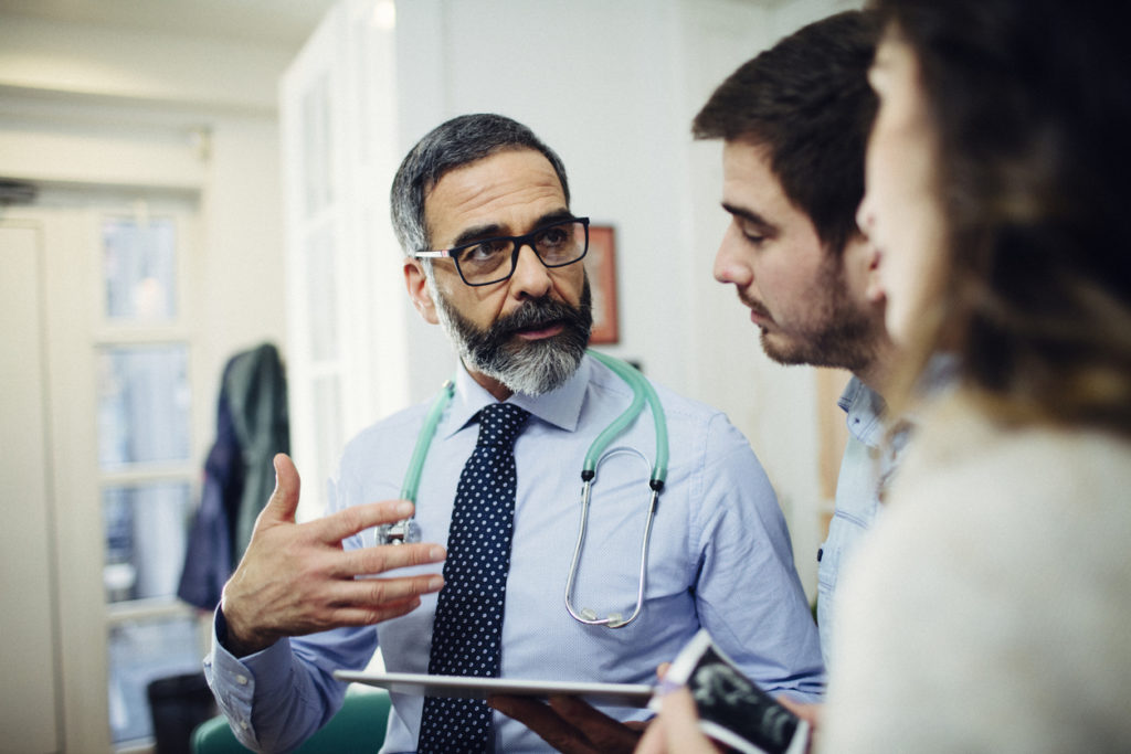 Doctor discussing diagnosis with patients