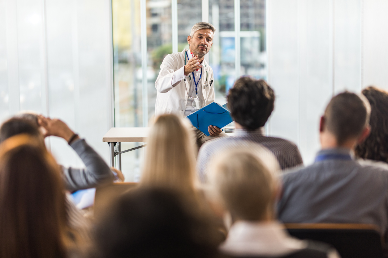 Doctor addressing a room of students