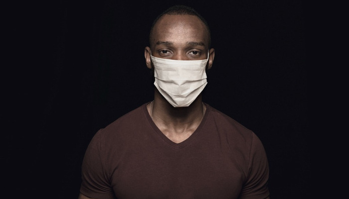 Black man in protective mask