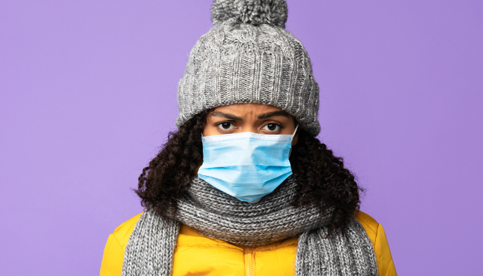 Black Girl Wearing Protective Medical Mask Standing On Purple Background